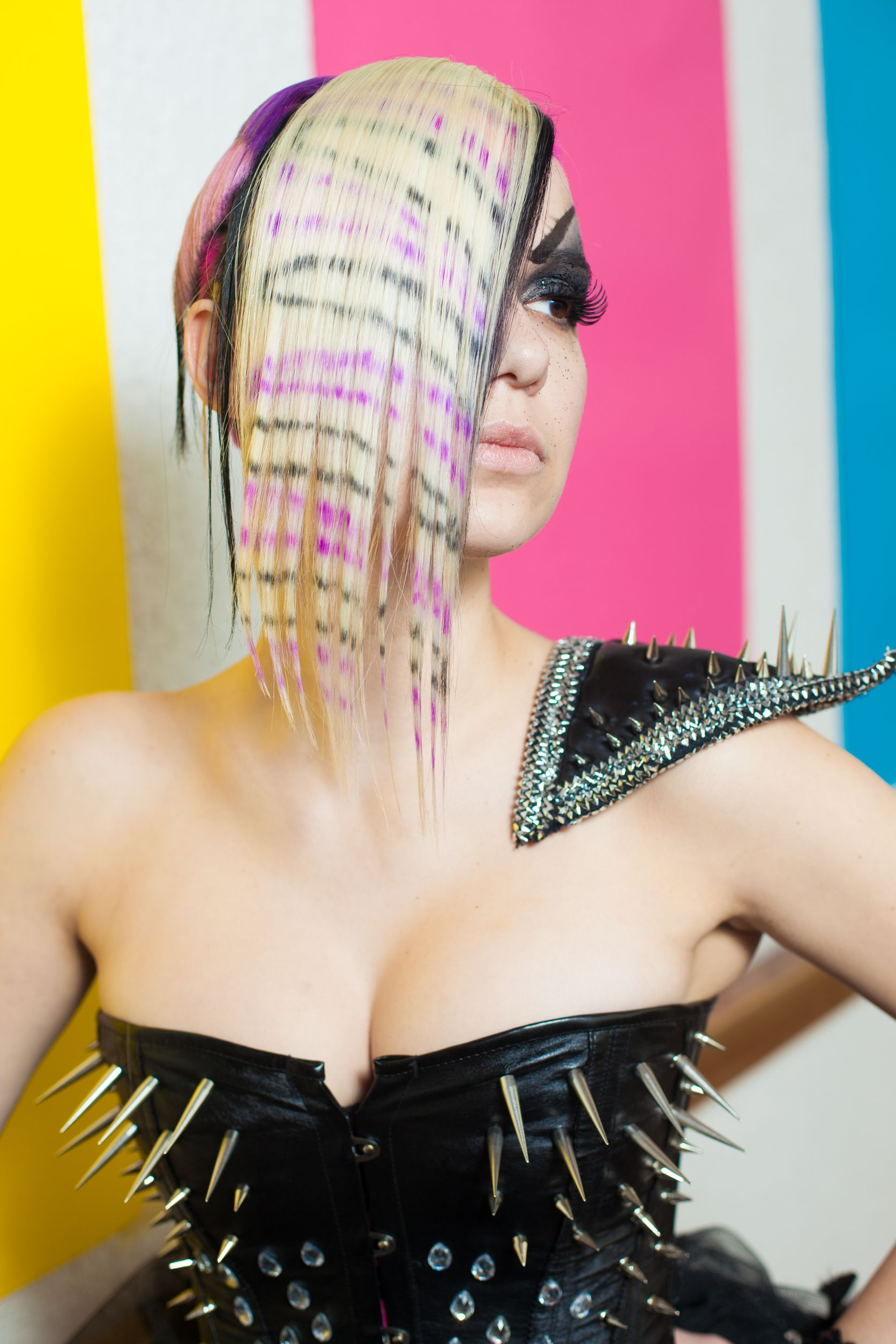 16300063 - woman with multicoloured hair and spike dress